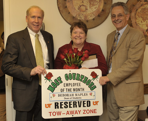 Deborah Maples of the Dean of Students Office receives the November Send Roses award from Vice Chancellor for Student Affairs Tim Rogers (left) and Executive Director of Human Resources Alan Chesney (right)