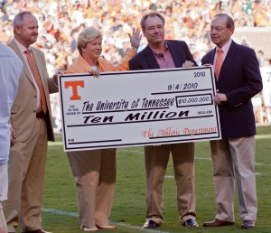A check for $10 million from UT Athletics is presented to UT academics. From left, men's athletic director Mike Hamilton, women's athletic director Joan Cronan, interim UT System President Jan Simek, and UT Knoxville Chancellor Jimmy G. Cheek.