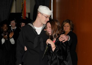 The brother and sister embrace after reuniting at commencement.