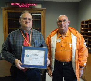 Construction Services Director Tim Tomlinson, left, receiving the Patriot Award. Electric Shop employee Willard Pippin, right, nominated Tomlinson for the award.