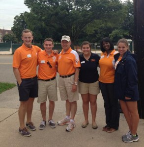 Chancellor Jimmy G. Cheek (third from left) and Assistant Vice Chancellor Melissa Shivers (second from right) pose with orientation leaders during the summer of 2013.