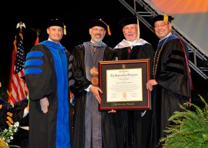 From left: Mike Wirth, dean of the College of Communication and Information; UT system President Joe DiPietro; Wilford; and UT Knoxville Chancellor Jimmy G. Cheek.