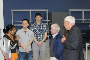 From left to right, Department of Electrical Engineering and Computer Science students Lakshmi Gopi Reddy, Zhiqiang Wang, and Zheyu Zhang, talk to Richard Hopkins and John Spitznagel of the II-VI Foundation.