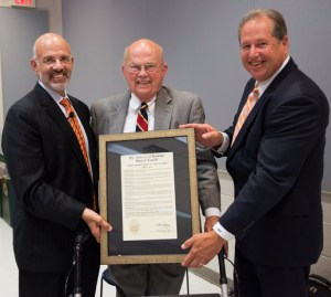 UT System President Emeritus Joe Johnson, center, receives the Trustees' Lifetime Achievement Award from current System President Joe DiPietro, left, and Board of Trustees Vice Chair J. Brian Ferguson, right.