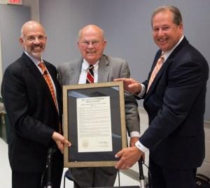 UT System President Emeritus Joe Johnson, center, receives the Trustees' Lifetime Achievement Award from current System President Joe DiPietro, left, and Board of Trustees Vice Chair J. Brian Ferguson, right.