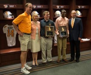 "Vols legend Peyton Manning presents the 2014 Peyton Manning Scholarships. From left: Manning, Provost Susan Martin, scholarship recipients Stephen Alexander ""Alex"" Crockett and Cody Sain, and Chancellor Jimmy G. Cheek."