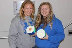 Harriman High School students Autumn Dayton, left, and Hayle Moore show off their successful design for the Engineers Day egg drop—a hollowed out Nerf football.