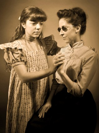 Rachel Finney, left, as Helen Keller, and Angela Church (right), star in the 2014 production of The Miracle Worker at Clarence Brown Theatre.