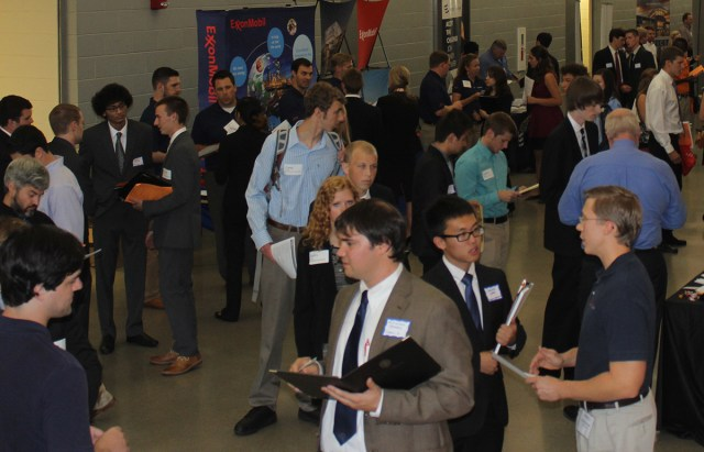 UT engineering students talk with representatives from Exxon/Mobil during the college's recent expo.