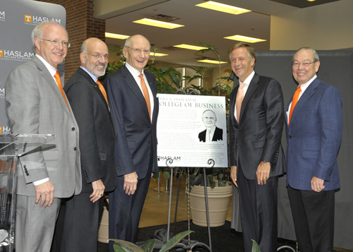 Business dean Steve Mangum, UT President Joe DiPietro, Jim Haslam, Governor Bill Haslam and UT Chancellor Jimmy G. Cheek stand around a plaque detailing Haslam's contribution to the school and the community.