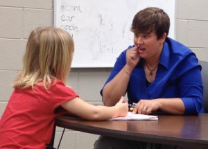 Mandy Burnside works with a deaf prekindergarten student.
