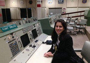 Carol Miselem in the Apollo-era flight director seat at Johnson Space Flight Center in Texas.