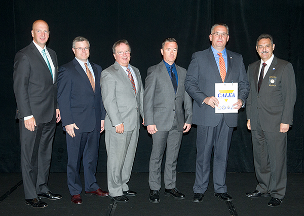 Pictured, left to right, are W. Craig Hartley Jr., executive director of CALEA; Chris Cimino, UT vice chancellor for finance and administration; Jeff Maples, UT senior associate vice chancellor for finance and administration; Lt. Mike Richardson, accreditation manager; Troy Lane, chief of police; and Richard Meyers, executive board president for CALEA.