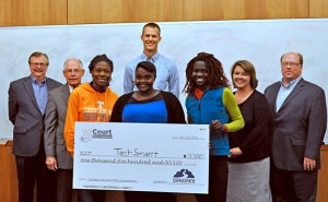 Members of the TechSmarrt team, (front row, left to right) Adeola Adediran, Eva Mutunga and Christine Ajinjeru are presented with a check by representatives of the sponsoring institutions. Presenters are (back row, left to right) Tom Graves, operations director of the Anderson Center for Entrepreneurship and Innovation; Tom Ballard, founder of Teknovation and chief alliance officer of Pershing Yoakley and Associates; Brandon Bruce, co-founder of Cirruspath; Stacey Patterson, vice president of the UT Research Foundation; and David Morehous, managing counsel of Morehous Legal Group.