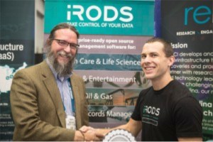 Dan Bedard, right, welcomes Gregory Peterson, director of the National Institute of Computational Sciences, to the iRODS Consortium in the RENCI booth at SC15.