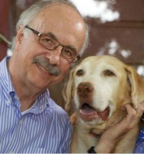 John Orme with his yellow Labrador retriever, Abby.