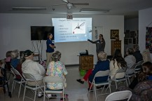 Junior Cole Spencer, left, and senior Stephanie Nabors, right, teach at a senior center about disease prevention during and after a flooding disaster in Clay County, Kentucky.