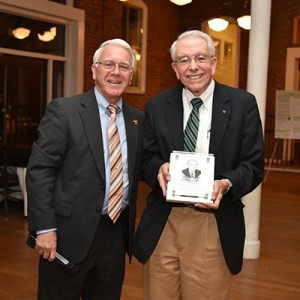 John Prados, right, stands with College of Engineering Dean Wayne Davis after his induction into the Department of Chemical and Biomolecular Engineering Hall of Fame.