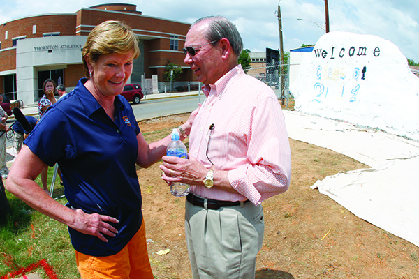 Lady Vol coach Pat Summit chats with Chancellor Jimmy G. Cheek as they take a break from painting a a message on The Rock welcoming incoming freshman Sunday, Aug. 15, 2010 (Photo by Wade Payne, Special to the News Sentinel)...