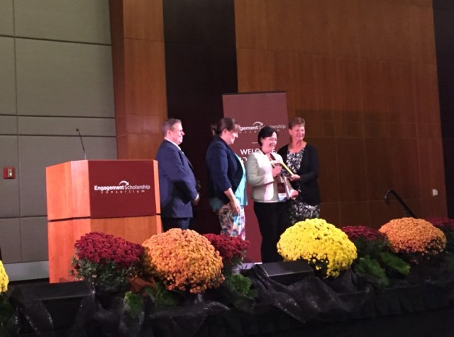Lisa Davenport (second from right) and Jenny Retherford (second from left) receive UT's 2016 Exemplary Award.