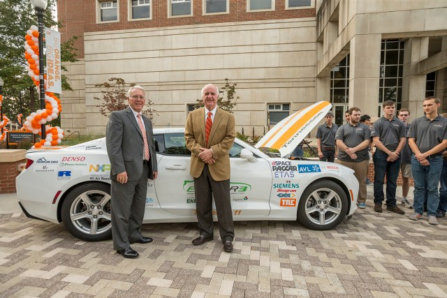 Tickle College of Engineering dean Wayne Davis, left, stands with John D. Tickle in front of UT's EcoCAR during the celebration of the naming of the college on Nov. 3.