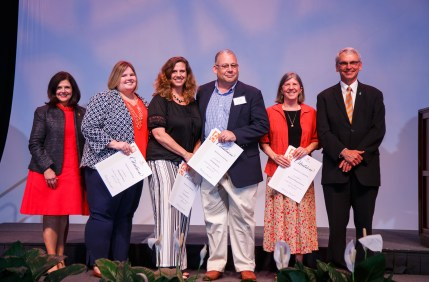 Excellence in Advising - Chancellor Davenport, Ashleigh Powers, Laura Trainer, Professor George Kuney, Professor Barbara Thayer-Bacon and Interim Provost John Zomchick.