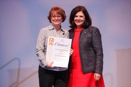 Chancellor's Citation for Extraordinary Community Service - Assistant Professor Laura Shannon Wheat and Chancellor Davenport.