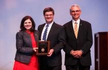 Alexander Award – Chancellor Davenport, Professor Ben Blalock and Interim Provost John Zomchick.