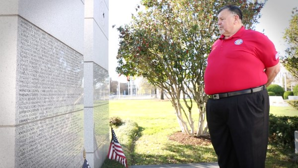 Bill Robinson looks on the names of his fallen brothers and sisters in arms at the East Tennessee Veteran's Memorial in Knoxville.