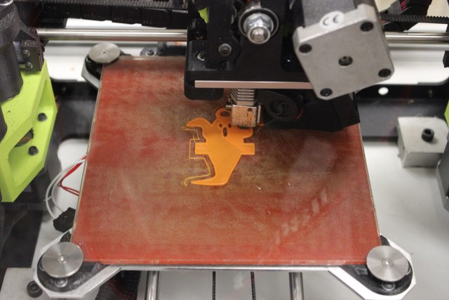 A printer makes a 3D image of a Halloween ghost for patients at East Tennessee Children's Hospital.