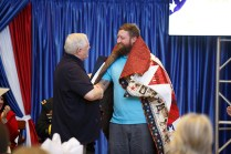 Brent Bennae of Clarksville, Tennessee, a senior in animal science, receives a Quilt of Valor on November 17 in a ceremony to open the new Veterans Resource Center. He served in the Army and Marine Corps for a combined 10 years.