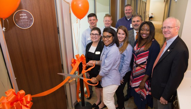 Front row: Pilot Flying J employees Kayla Dobbins, Carla Huff, Candace Hawkes, and Gerrica Caldwell, and Haslam College of Business Dean Steven Mangum. Second row: Pilot Flying J employees Tyler Williams, Andy Goodman, Erik Younger, and Vice President of Talent Acquisition Paul Shore.