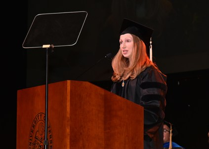 Kerri Ann Considine, a postdoctoral lecturer in the Department of English, speaks at the graduate hooding ceremony on December 14, 2017.