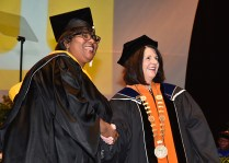 Chancellor Beverly Davenport poses for a photograph with a student during the graduate hooding ceremony on December 14, 2017.