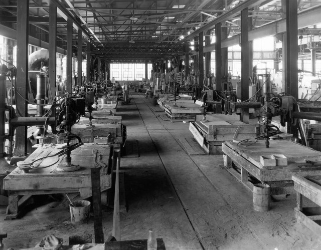 Historical photo of interior of marble processing plant