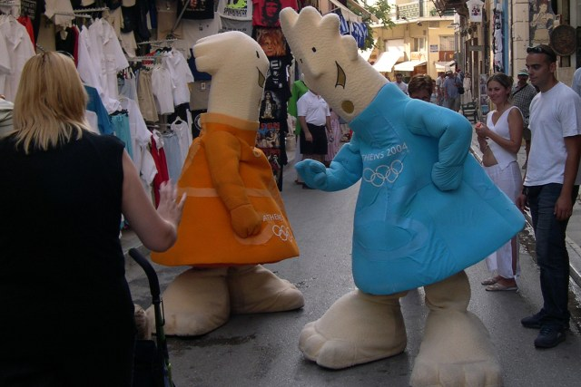 Olympic mascots greet people on the streets of Athens during the 2004 Olympic Games in Athens, Greece. (Photo by Michael T. Martinez)