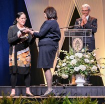Outstanding students and faculty members are recognized during the Chancellor's Honor Banquet at the Knoxville Convention Center on Tuesday, April 17, 2018. Here is Marilyn Kallet, left, being presented the L.R. Hesler Award, by Chancellor Beverly Davenport, center, as Interim Provost and Senior Vice Chancellor John Zomchick applauds...Photo by Erik Campos..41234