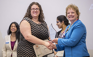 Jessica Vélez, a PhD candidate in the UT–Oak Ridge National Laboratory Bredesen Center for Interdisciplinary Research and Graduate Education, is congratulated by Graduate School Dean Dixie Thompson at the Three-Minute Thesis competition.