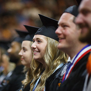 Faces of graduates in line during commencement