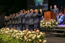 Lt. Col Jared A. Crain swears in newly commissioned military officers and graduates of the University of Tennessee's College of Arts and Sciences during their commencement at Thompson-Boling Arena on Saturday, May 12, 2018...Photo by Erik Campos