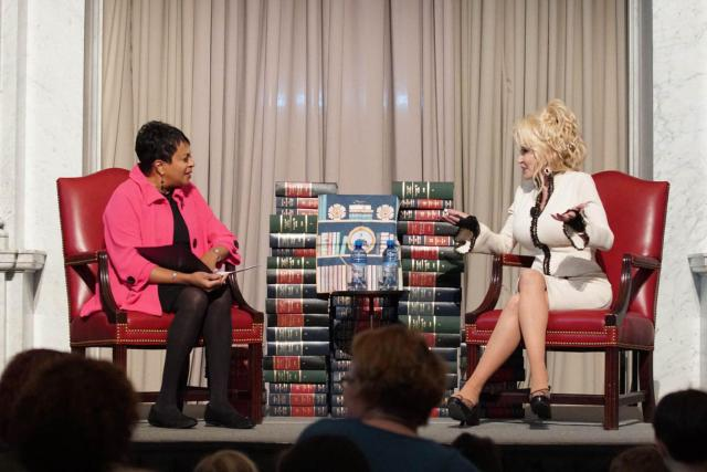 Carla Hayden, left, and Dolly Parton talk during the a celebration of the Imagination Library at the Library of Congress in February.