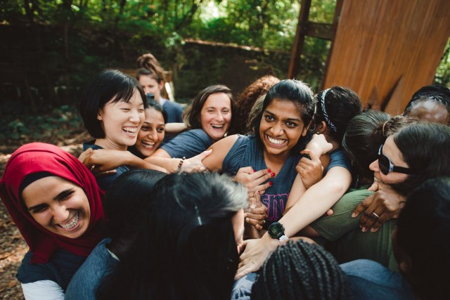 Participants in the 2017 GSMP: Empower Women through Sports exchange form a group hug during a teambuilding exercise at Terrapin Adventures in Savage, Md.