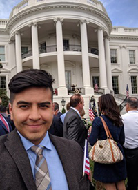 Jorge Narvaez poses for a selfie at an event in the White House's South Lawn.