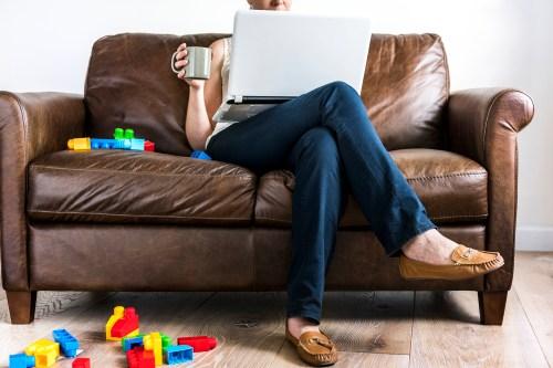 Woman using laptop at sofa