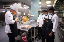 Students work in the UT Conference Center kitchen as part of a culinary boot camp with Chef Greg on September 16, 2020. Photo by Steven Bridges/University of Tennessee