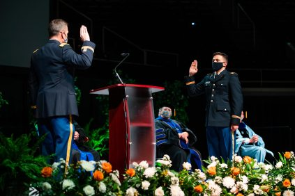A student in uniform takes an oath to the US Military.