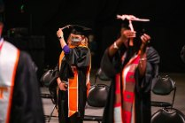 A graduate moves their tassel from right to left during commencement.