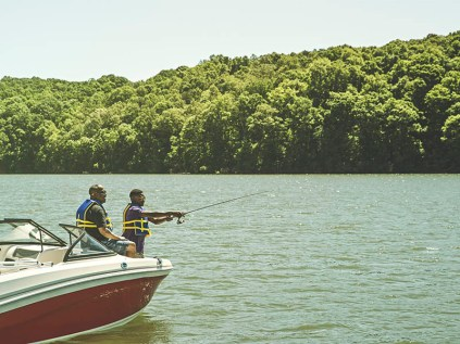 Father and son fish on boat in Loudon County.