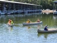 Kids in boats sit in calm water in Hardin County