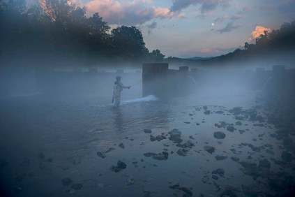 fly fishing in misty morning